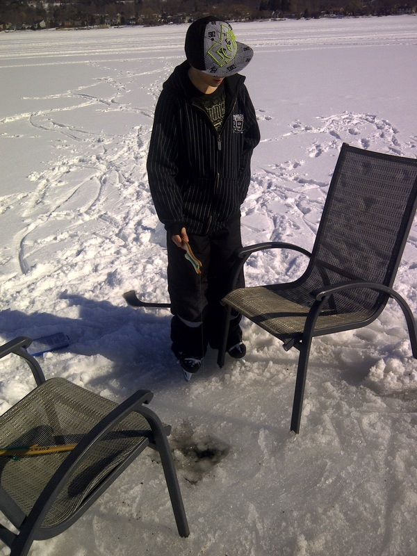 Ice Fishing in front on the cottage rental Ontario.